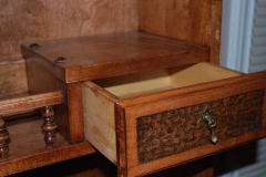 Small drawer in the top part of hutch