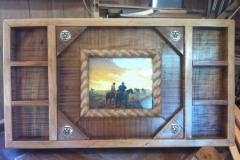 Rough cut cherry frame with rope border.  Holds  7 to 9 buckles